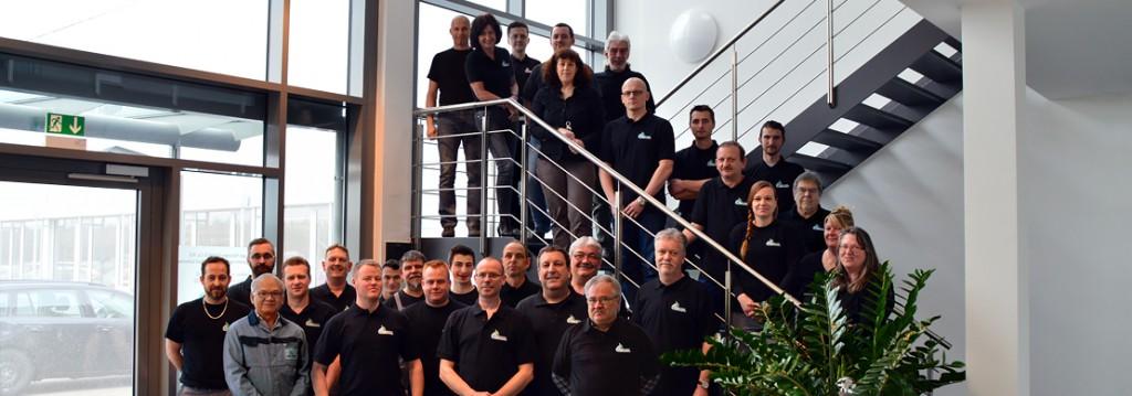 Das Team von Riexinger im Eingangsbereich